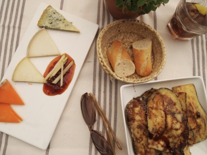 a cheese platter with tomato jam and fried eggplant drizzled with honey in Barcelona