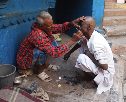 shaving before a family cremation ceremony