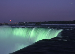 Brink of the Falls lit up at night
