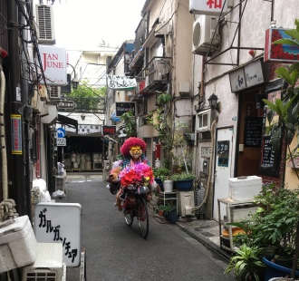 ion on a bicycle at Golden Gai