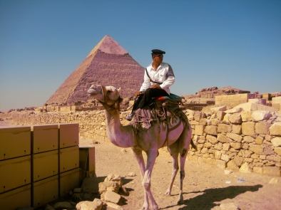 policeman on camel with Khafre's Pyramid in the background