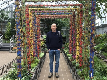 Mike in a tunnel of flowers