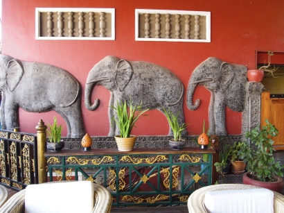 elephants march through the restaurant
