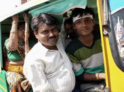 rickshaws filled to capacity in Varanasi