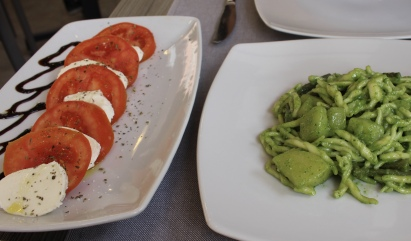 caprese salad and pasta with pesto