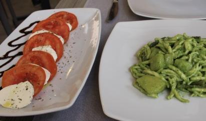 caprese salad and pasta with pesto