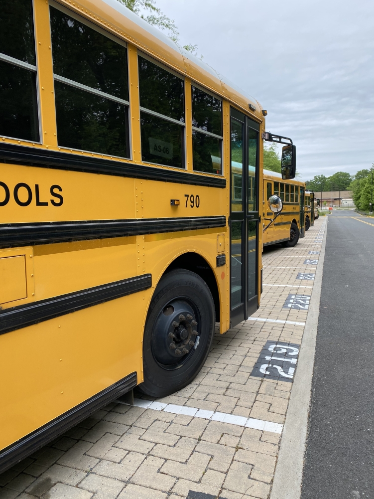 empty school buses parked at South Lakes High School