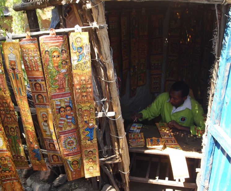 an artist paints scrolls at Lalibela