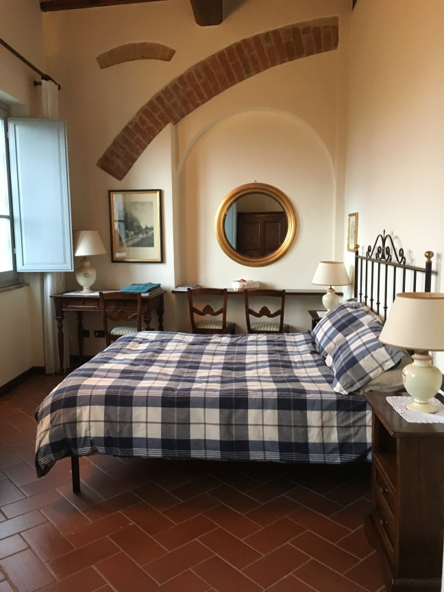 the bedroom in our apartment at Castello di Fulignano