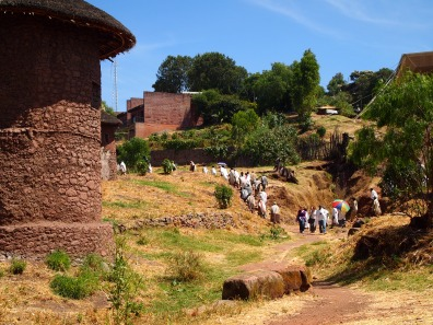 a column of worshipers leaves the Lalibela church of Bet Mikael