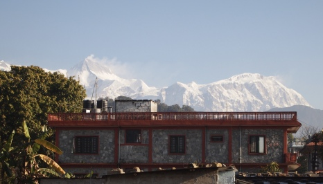 peeks at the Himalayas as I walk around town