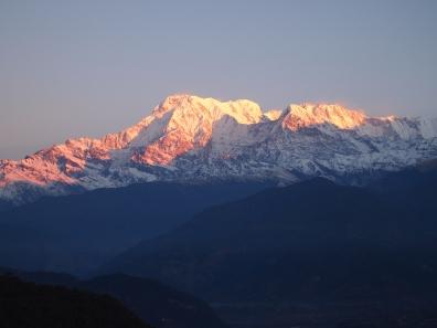 blushing mountain peaks