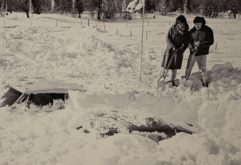 On March 6, 1966, these two Grand Forks residents faced a major excavation job to fee their vehicles from the infamous blizzard's aftermath.