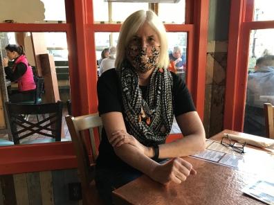 me at Oscar's Cafe in Springdale with mask